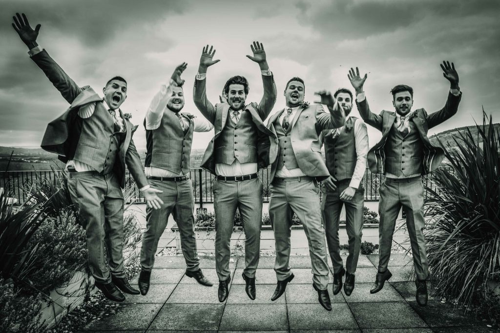 groom_jump_funny_wedding_photography_bristol